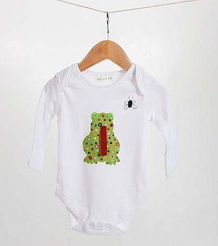 Watch out little fly, frog is about! A lovely bodysuit for any little boy. The frog is hand sewn on using green and mixed spotty material with two green buttons for the eyes and a strip of red material for its tongue, while the fly is hand sewn on using black thread.