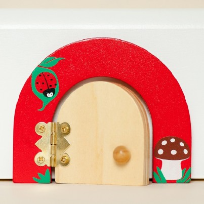 Lottie the ladybird fairy door & fairy dust gift set  A gift set containing a red fairy door with a cute ladybird & toadstool.  Our fairy doors open for that extra bit of magic.  Each door comes with matching fairy dust, a FREE fairy scene & FREE fixers!