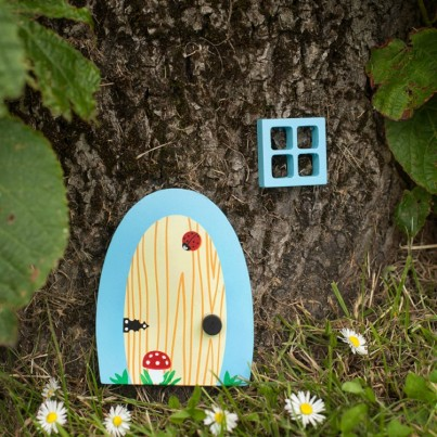 Bluebell Garden & Home Fairydoorz  A sky blue wooden fairy door designed by fairydoorz in a set with a matching wooden window.  All weather proofed for outside use.  Perfect for against decking steps, a fence, wall or tree!  These doors can be used as indoor fairydoorz too!  The design is a wood effect grain with ladybird & toadstool.  Ready to welcome in any fairies & bright enough to stand out in any garden!  High quality magical decorations to brighten up your day!