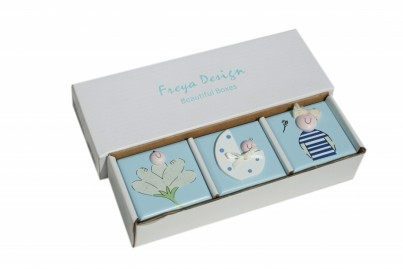 Set of 3 small keepsake trinket boxes - One tooth Fairy ( first tooth): one for first lock of hair: one for the baby birthing band.  All the three items are painted with non-toxic paints and we have decided to leave the inside of the boxes unpainted in order to retain the natural smell of wood.