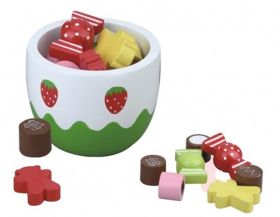 Bowl of Delicious Wooden Sweets and Treats
