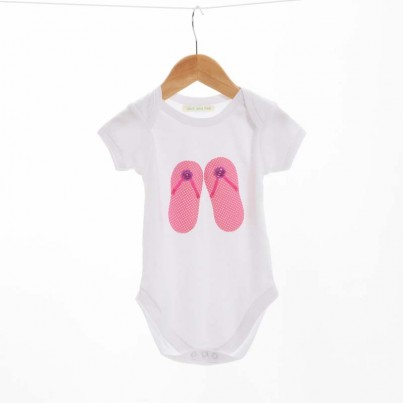 Lets go to the beach! A lovely hand sewn flip flop bodysuit using pink spotty material with pink ribbon for the straps and two flower buttons.  The idea behind the design is my daughters love of all pink shoes! We hope the little one enjoys wearing it as much as we have enjoyed making it.