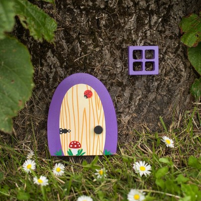 Violet Garden & Home Fairydoorz  A vivid violet wooden fairy door designed by fairydoorz in a set with a matching wooden window.  All weather proofed for outside use.  Perfect for against decking steps, a fence, wall or tree!  These doors can be used as indoor fairydoorz too!  The design is a wood effect grain with ladybird & toadstool.  Ready to welcome in any fairies & bright enough to stand out in any garden!  High quality magical decorations to brighten up your day!