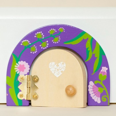 Susannah the Secret Garden fairy, fairy door & fairy dust gift set, by fairydoorz  A gift set containing a beautifully patterned purple fairy door with flowers & leaves.  Our fairy doors open for that extra bit of magic. Each door comes with matching fairy dust, a FREE fairy scene & FREE fixers!
