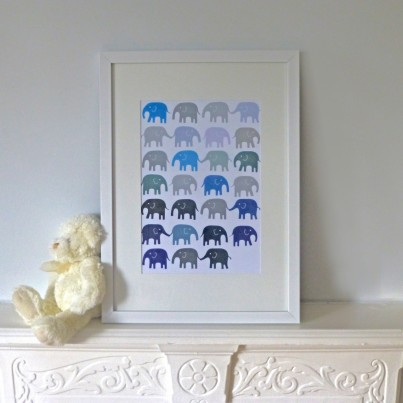 Navy blue and grey elephants in a row.